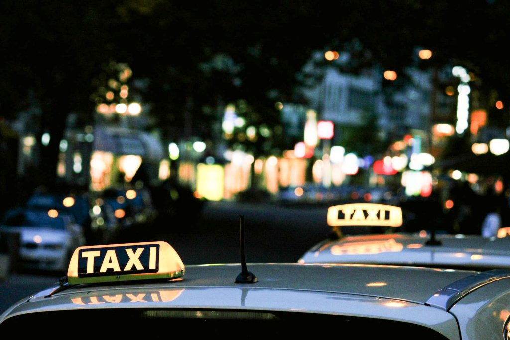 Taxi in Big City at night